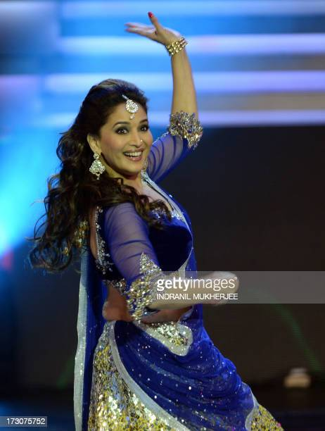 Indian Bollywood actor Madhuri Dixit Nene performs at the 14th International Indian Film Academy Award ceremony at The Venetian hotel in Macau on...
