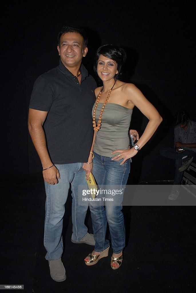 Indian Bollywood actor Mandira Bedi along with her husband Raj Kaushal during the Blackberrys Sharp Night Fashion Show at Mehboob studio, Bandra on May 3, 2013 in Mumbai, India. The Blackberrys Sharp Night is a fashion show organised by Blackberrys to showcase their new Summer/Spring collection.