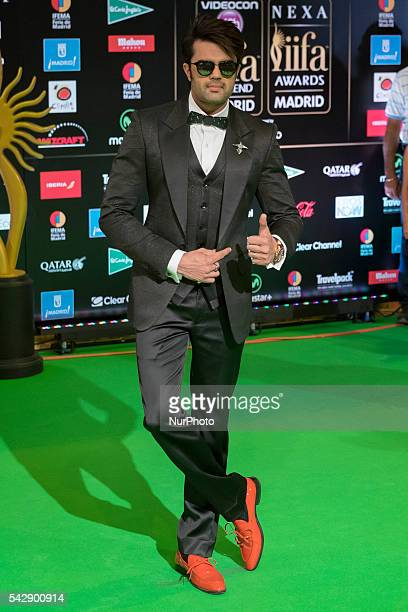 Indian Bollywood actor Manish Pons poses on the green carpet as she arrives to the 17th edition of IIFA Awards in Madrid on June 24 2016