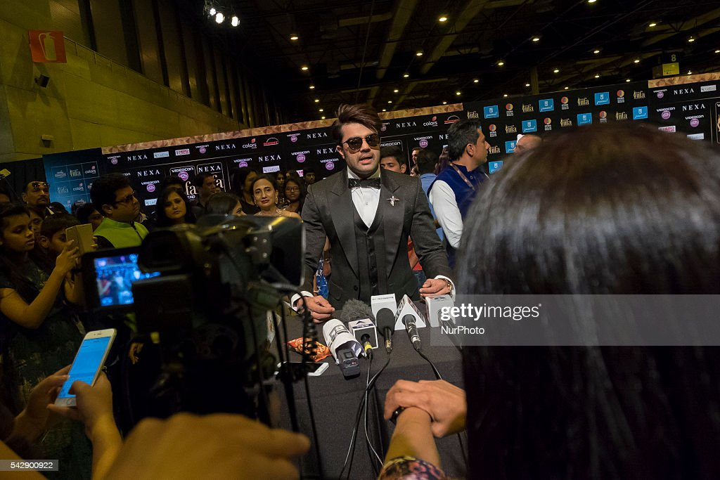 Indian Bollywood actor Manish Pons poses on the green carpet as she arrives to the 17th edition of IIFA Awards (International Indian Film Academy Awards) in Madrid on June 24, 2016.