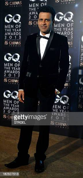 Indian Bollywood actor Manoj Bajpai poses as he attends the GQ India fifth anniversary 'Men of the Year' Awards ceremony in Mumbai late September 29...