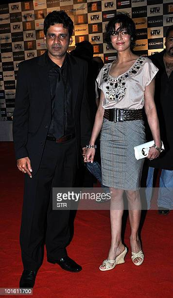 Indian Bollywood actor Manoj Bajpai with wife Neha attend the premiere of Prakash Jha�s political Hindi film 'Rajneeti' in Mumbai on June 3 2010 AFP...