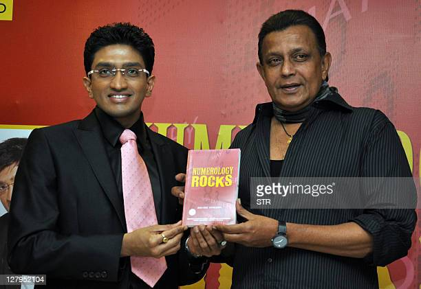 Indian Bollywood actor Mithun Chakraborty poses for a photo during the release of a book 'Numerology Rocks' by astrologer Bhavikk Sanggvi in Mumbai...