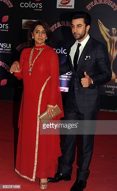 Indian Bollywood actor Neetu Singh and her son Ranbir Kapoor attend the 14th Stardust Awards 2016 ceremony in Mumbai on December 19 2016 / AFP /...