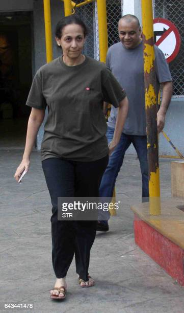Indian Bollywood actor Paresh Rawal and his wife Swaroop Sampat leave after casting their votes in civic elections in Mumbai on February 21 2017 /...