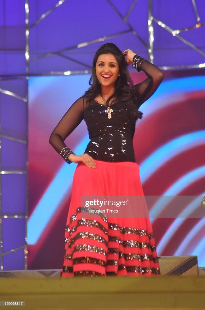 Indian bollywood actor Parineeti Chopra performing during the Umang Mumbai Police Annual Show 2013 at Andheri Sports Complex on January 5, 2013 in Mumbai, India.