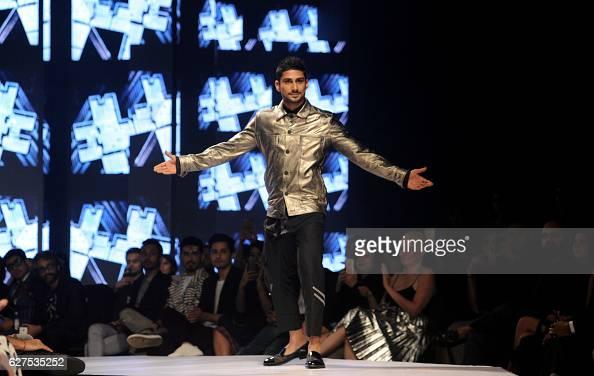 Indian Bollywood actor Pateik Babbar walks the catwalk at the GQ Fashion Nights 2016 menswear fashion show in Mumbai on December 3 2016 / AFP /