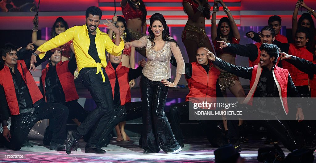 Indian Bollywood actor Prabhudeva (C-L) and Sridevi Kapoor (C-R) perform at the 14th International Indian Film Academy (IIFA) Award ceremony at The Venetian hotel in Macau on July 6, 2013. The annual IIFA Awards, India's Hindi language film industry, Bollywood's glitziest awards ceremony, which have been held overseas for the last 13 years, is one of the world's most-watched annual entertainment ceremonies, broadcast to nearly 500 million viewers in 110 countries. AFP PHOTO/Indranil MUKHERJEE