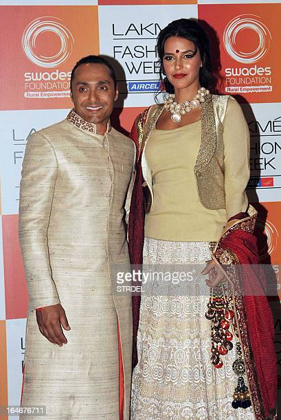 Indian Bollywood actor Rahul Bose poses with actress Neha Dhupia as they attend a fashion show by designer Vikram Phadnis supporting the 'Swades...