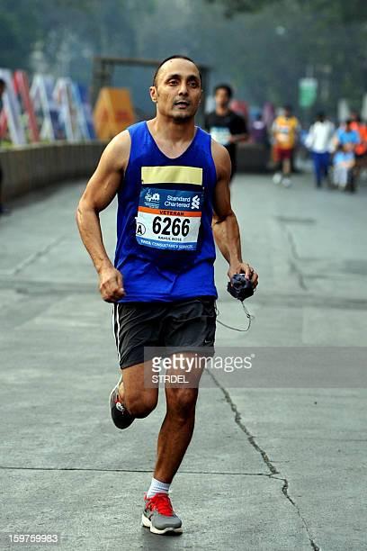 Indian Bollywood actor Rahul Bose takes part in the Mumbai Marathon on January 20 2013 AFP PHOTO