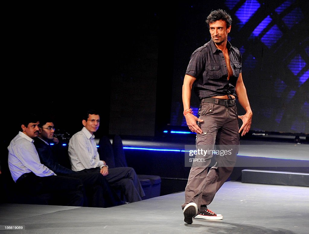Indian Bollywood actor Rahul Dev walks the ramp during a Future Lifestyle Fashion event in Mumbai on November 21, 2012. AFP PHOTO/STR