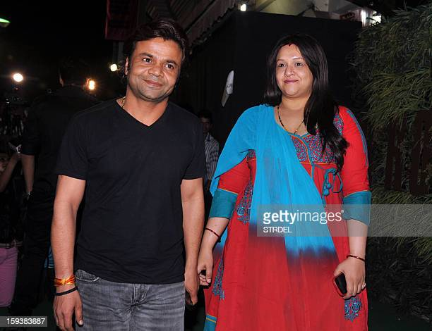 Indian Bollywood actor Rajpal Yadav with wife Radha during the inauguration of a furniture showroom by actors Sunil and Mana Shetty in Mumbai on...