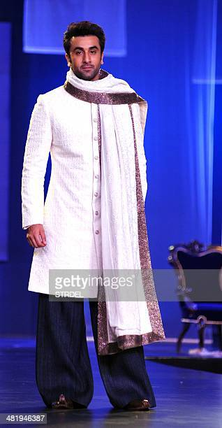 Indian Bollywood actor Ranbir Kapoor models a creation by designer Manish Malhotra during a charity fashion show in Mumbai on late April 1 2014 AFP...