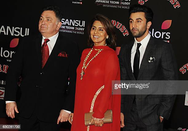 Indian Bollywood actor Ranbir Kapoor with his parents Rishi Kapoor and Neetu Singh attend the 14th Stardust Awards 2016 ceremony in Mumbai on...