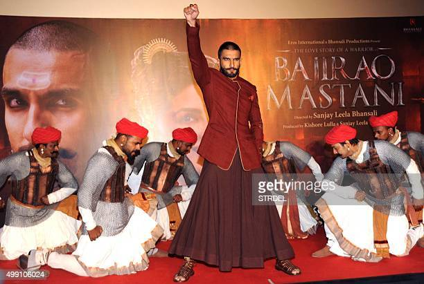 Indian Bollywood actor Ranveer Singh dances during a promotional event for the forthcoming Hindi film 'Bajirao Mastani' directed by Sanjay Leela...