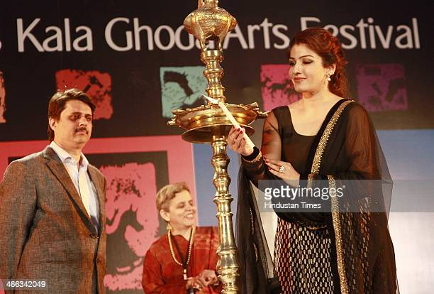 Indian Bollywood actor Raveena Tandon lighting the lamp during the opening ceremony of Kala Ghoda Arts Festival at Cross Maidan on Febuary 1 2013 in...