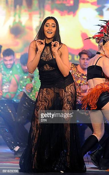 Indian Bollywood actor Regina Cassandra performs with dancers during the announcement of the forthcoming Hindi film Aankhen 2 directed by Anees...