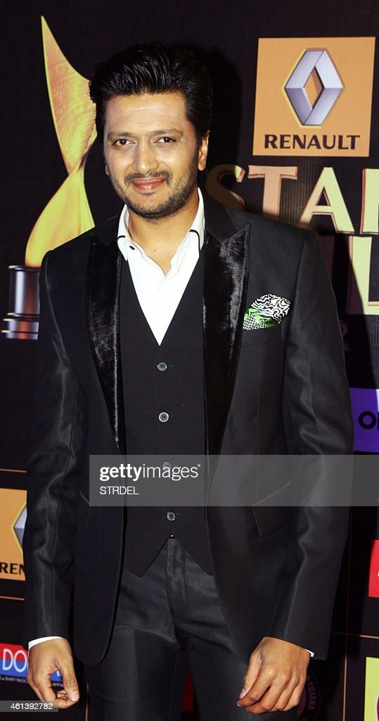 Indian Bollywood actor <a gi-track='captionPersonalityLinkClicked' href=/galleries/search?phrase=Ritesh+Deshmukh&family=editorial&specificpeople=4141905 ng-click='$event.stopPropagation()'>Ritesh Deshmukh</a> poses for a photograph during the 'Star Guild Awards 2015' in Mumbai on late January 11, 2015. AFP PHOTO / STR