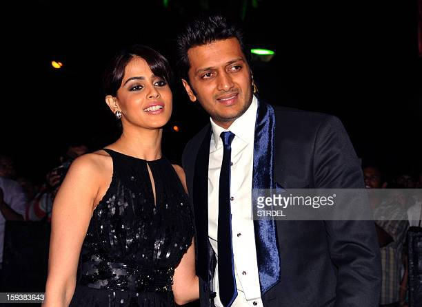 Indian Bollywood actor Ritesh Deshmukh with wife Genelia Dsouza during the inauguration of a furniture showroom by actors Sunil and Mana Shetty in...