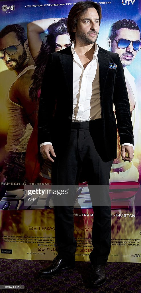 Indian Bollywood actor Saif Ali Khan poses for pictures during a photo call for his new action thriller film 'Race 2' in London on January 14, 2013. AFP PHOTO/BEN STANSALL