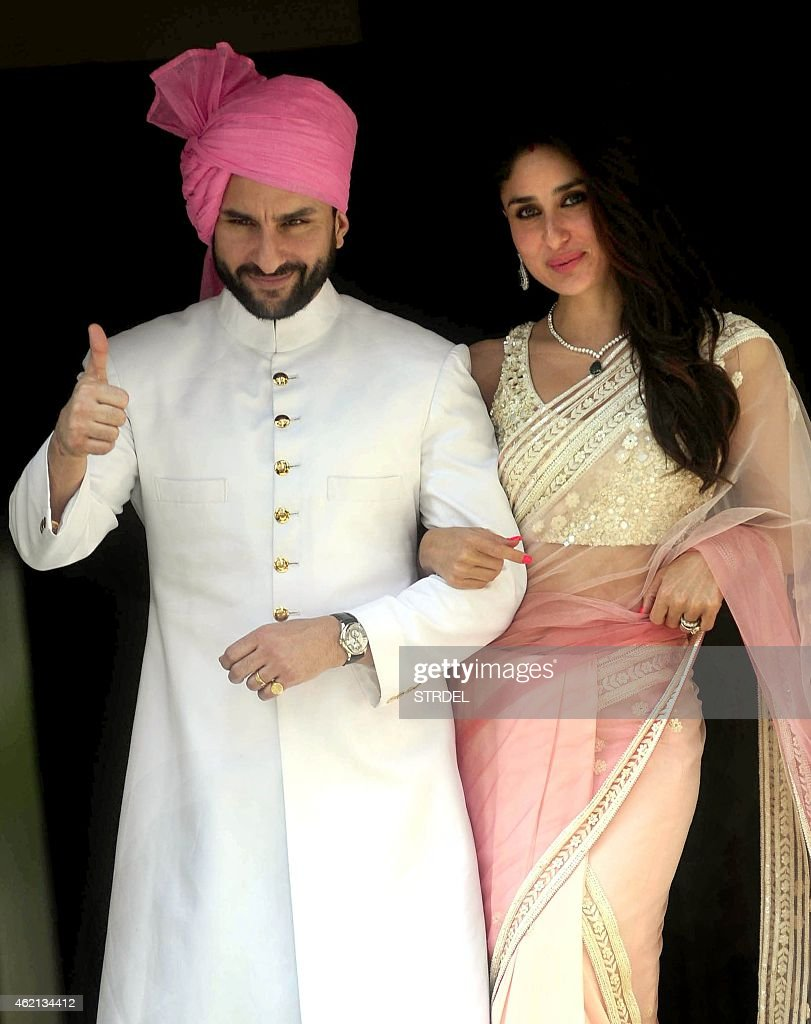 Indian Bollywood actor <a gi-track='captionPersonalityLinkClicked' href=/galleries/search?phrase=Saif+Ali+Khan&family=editorial&specificpeople=3117032 ng-click='$event.stopPropagation()'>Saif Ali Khan</a> (L) with his wife <a gi-track='captionPersonalityLinkClicked' href=/galleries/search?phrase=Kareena+Kapoor&family=editorial&specificpeople=855270 ng-click='$event.stopPropagation()'>Kareena Kapoor</a> Khan attend the wedding of Soha Ali Khan and Kunal Khemu in Mumbai on January 25, 2015.