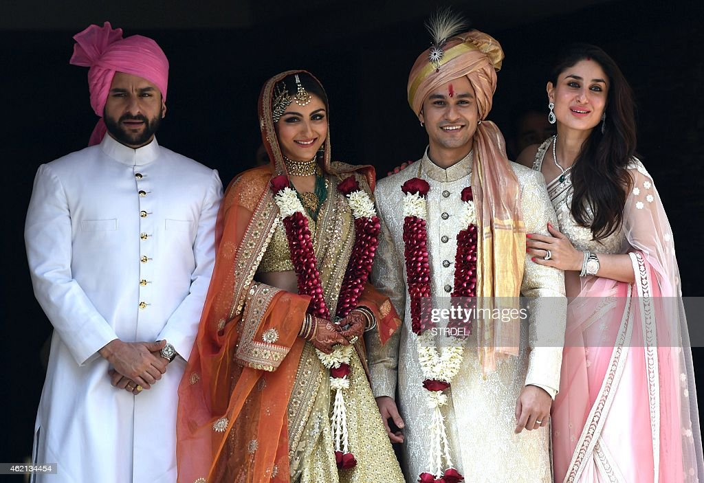 Indian Bollywood actor Saif Ali Khan with his wife Kareena Kapoor Khan attend the wedding of Soha Ali Khan and Kunal Khemu in Mumbai on January 25...
