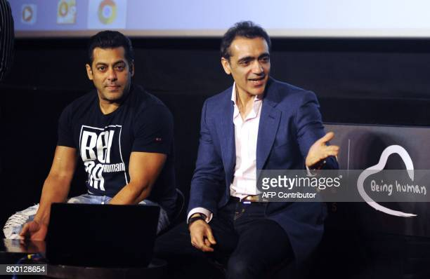 Indian Bollywood actor Salman Khan and CEO of PVR Ajay Bijli attend the announcement of their association with Being Human Foundation to support...