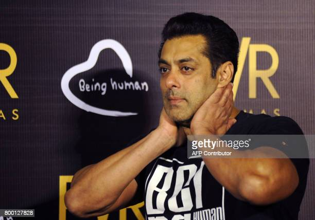 Indian Bollywood actor Salman Khan gestures during the announcement of his association with PVR Cinema and Being Human Foundation to support their...