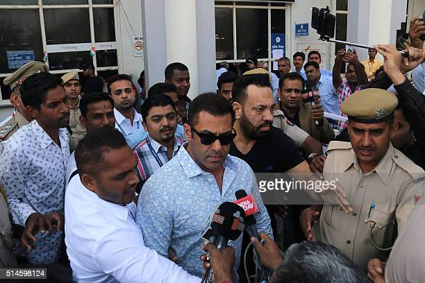 Indian Bollywood actor Salman Khan leaves the airport in Jodphur on his way to a court to give a statement related to a poaching case dating back...
