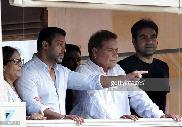 Indian Bollywood actor Salman Khan mother Salma father Salim Khan and Arbaaz Khan stand on the balcony on arrival at his house in Galaxy Apartment...