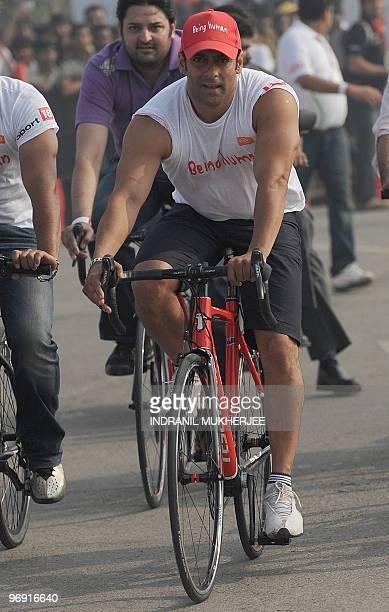 Indian Bollywood actor Salman Khan rides a bicycle before the start of the inaugural Tour de Mumbai Cycloyhon in Mumbai on February 21 2010...