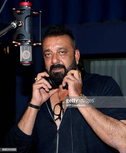 Indian Bollywood actor Sanjay Dutt looks on during the recording of the song 'Ganesh Aarti' for upcoming Hindi film 'Bhoomi' in Mumbai on August 2017...