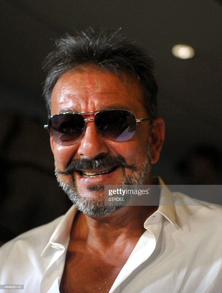 Indian Bollywood actor <a gi-track='captionPersonalityLinkClicked' href=/galleries/search?phrase=Sanjay+Dutt&family=editorial&specificpeople=1541020 ng-click='$event.stopPropagation()'>Sanjay Dutt</a>, on two weeks furlough from his prison sentence, attends a special screening of his Hindi film 'PK' in Mumbai on December 25, 2014.