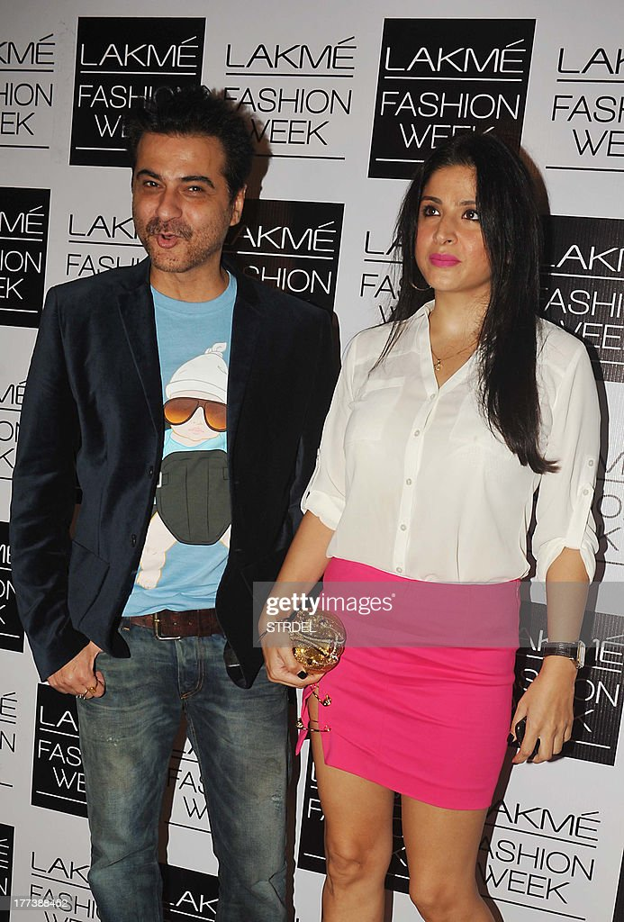Indian Bollywood actor Sanjay Kapoor and wife attend the Lakme Fashion Week (LFW) Winter/Festival 2013 in Mumbai on August 22, 2013.