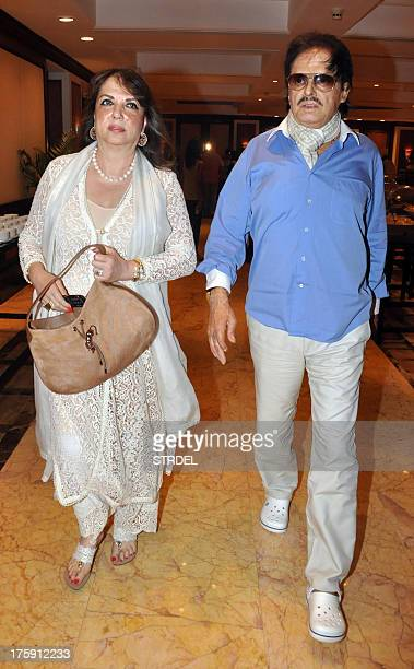 Indian Bollywood actor Sanjay Khan and his wife Zarine Khan walk during the unveiling of a statue of the late Bollywood actor Rajesh Khanna in Mumbai...