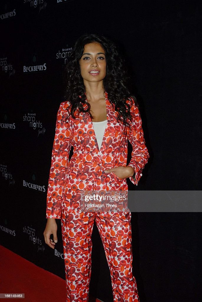 Indian Bollywood actor Sarah Jane Dias during the Blackberrys Sharp Night Fashion Show at Mehboob studio, Bandra on May 3, 2013 in Mumbai, India. The Blackberrys Sharp Night is a fashion show organised by Blackberrys to showcase their new Summer/Spring collection.