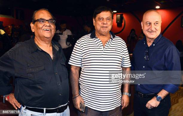 Indian Bollywood actor Satish Kausik film director David Dhawan and actor Anupam Kher attend the trailer launch of upcoming Hindi film 'Ranchi...