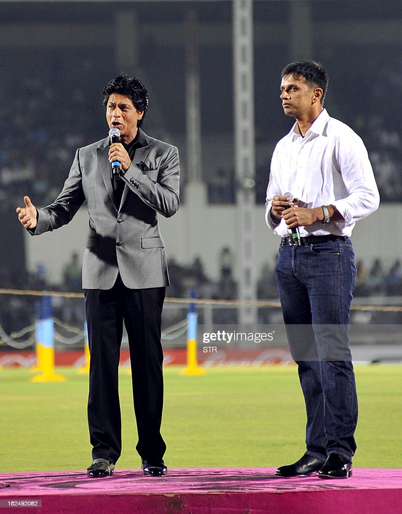 Indian Bollywood actor Shah Rukh Khan (L) and former Indian cricketer Rahul Dravid launch the grand opening ceremony of the Toyota University Cricket Championship (TUCC) first match of the season in Mumbai on February 23, 2013.