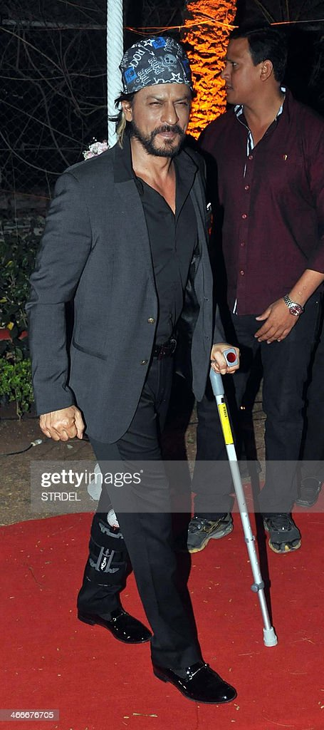 Indian Bollywood actor Shah Rukh Khan arrives to attend the wedding reception of actress Ahana Deol and husband Vaibhav Vohra in Mumbai on February 2, 2014.