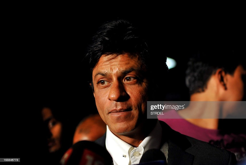 """Indian Bollywood actor Shah Rukh Khan attends the premier of the Hindi film """"Chittagong"""" directed by Bedabrata Pain in Mumbai on October 3, 2012."""