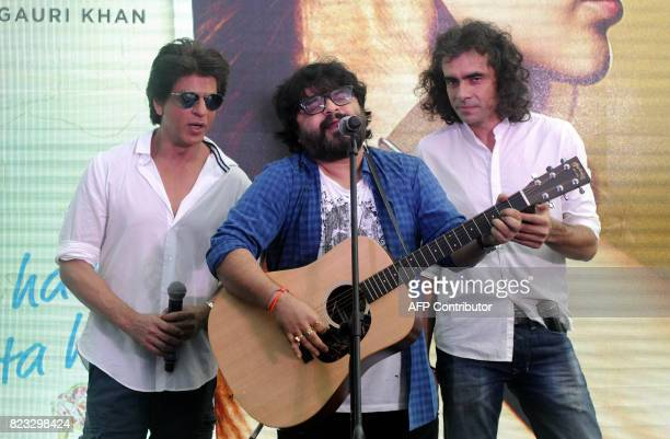 Indian Bollywood Actor Shah Rukh Khan music director Pritam Chakraborty and film director Imtiaz Ali take part in a promotional event for the...