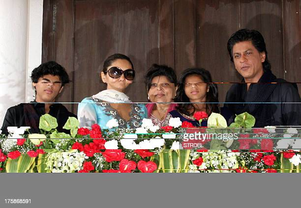 Indian Bollywood actor Shah Rukh Khan pictured with his family son Aryan Khan wife Gauri Khan sister Shehnaz and daughter Suhana pose during an event...