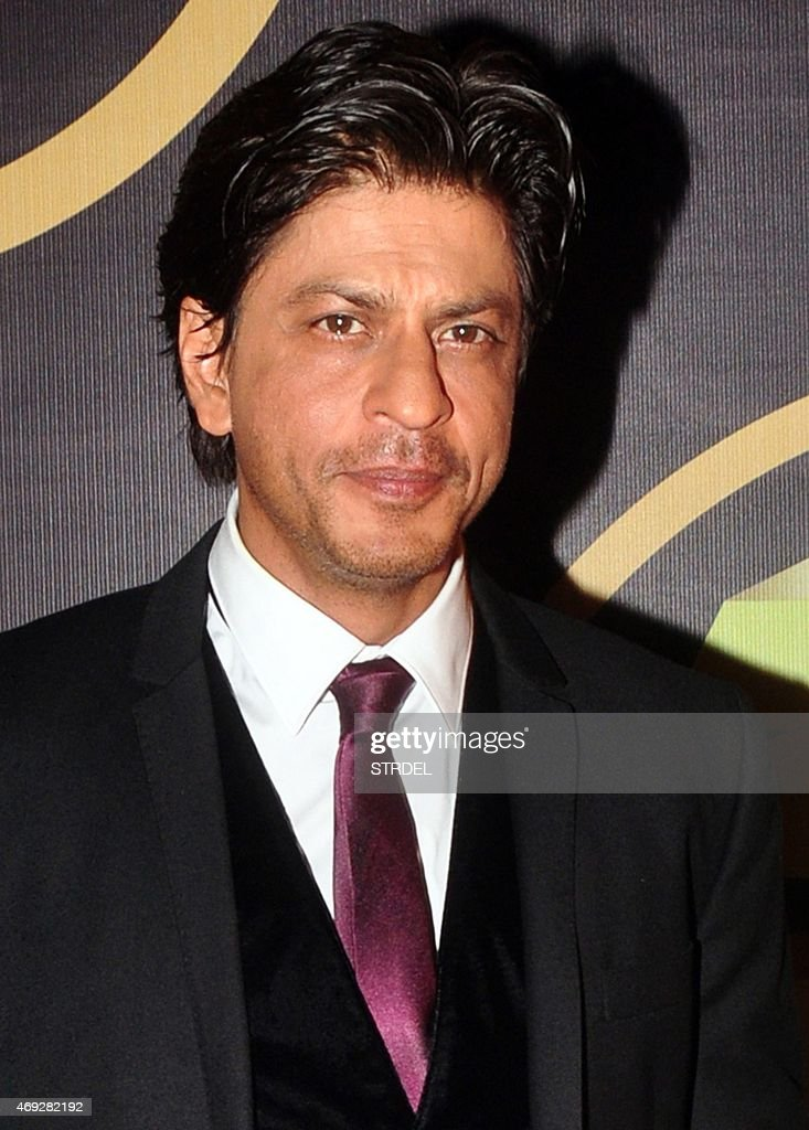 Indian Bollywood actor Shah <b>Rukh Khan</b> poses for a photograph during the 'NRI <b>...</b> - indian-bollywood-actor-shah-rukh-khan-poses-for-a-photograph-during-picture-id469282192