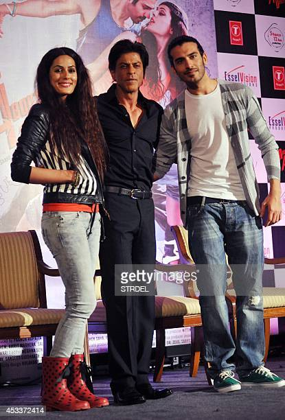 Indian Bollywood actor Shah Rukh Khan poses with actor Saahil Prem and actress Amrit Maghera at the unveiling of the application 'The MAD Wall of...