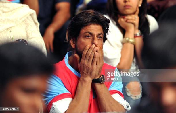 Indian Bollywood actor Shah Rukh Khan reacts during a professional kabaddi league match in Mumbai on late July 26 2014 AFP PHOTO/STR