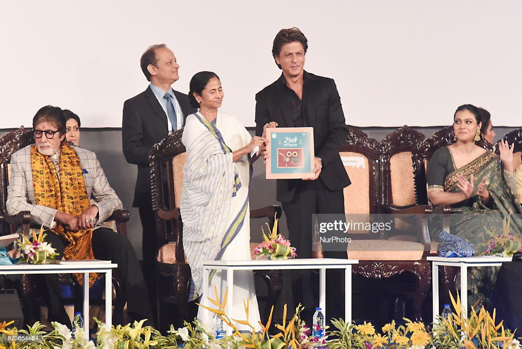 Indian Bollywood actor Shah Rukh Khan releases the festival souvenir along Mamata Banerjee CM of West Bengal at the inauguration of the 23rd Kolkata International Film Festival in Kolkata, India.
