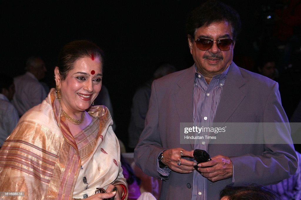 Indian bollywood actor Shatrughan Sinha with his wife Poonam Sinha during the unveiling of Yash Chopra's statue by his wife Pamela Chopra at Yash Raj Studio on February 11, 2013 in Mumbai, India.