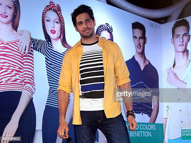 Indian Bollywood actor Sidharth Malhotra poses for a photograph during a promotional event in Mumbai on late January 18 2017 / AFP / STR