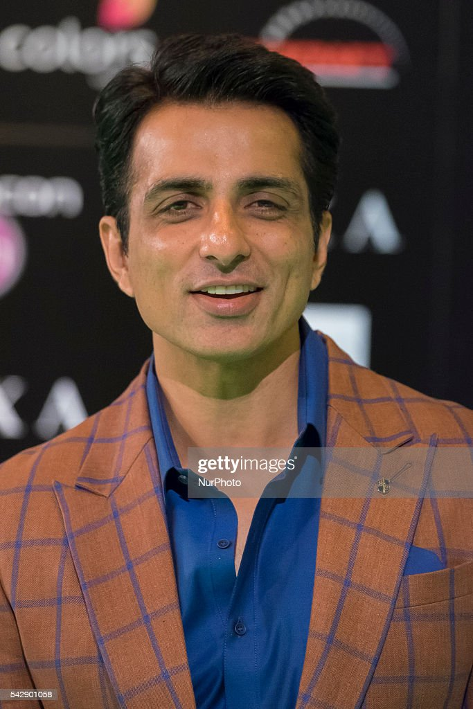 Indian Bollywood actor Sonu Sood poses on the green carpet as she arrives to the 17th edition of IIFA Awards (International Indian Film Academy Awards) in Madrid on June 24, 2016.