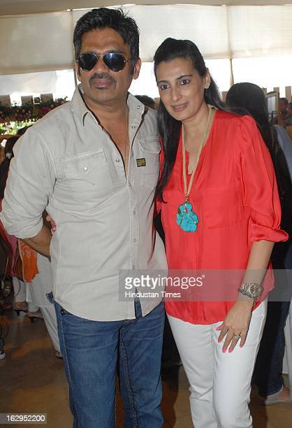Indian bollywood actor Suneil Shetty with his wife Mana Shetty at charity exhibition 'Aariash' organised by Mana Shetty for 'Save The Children' NGO...